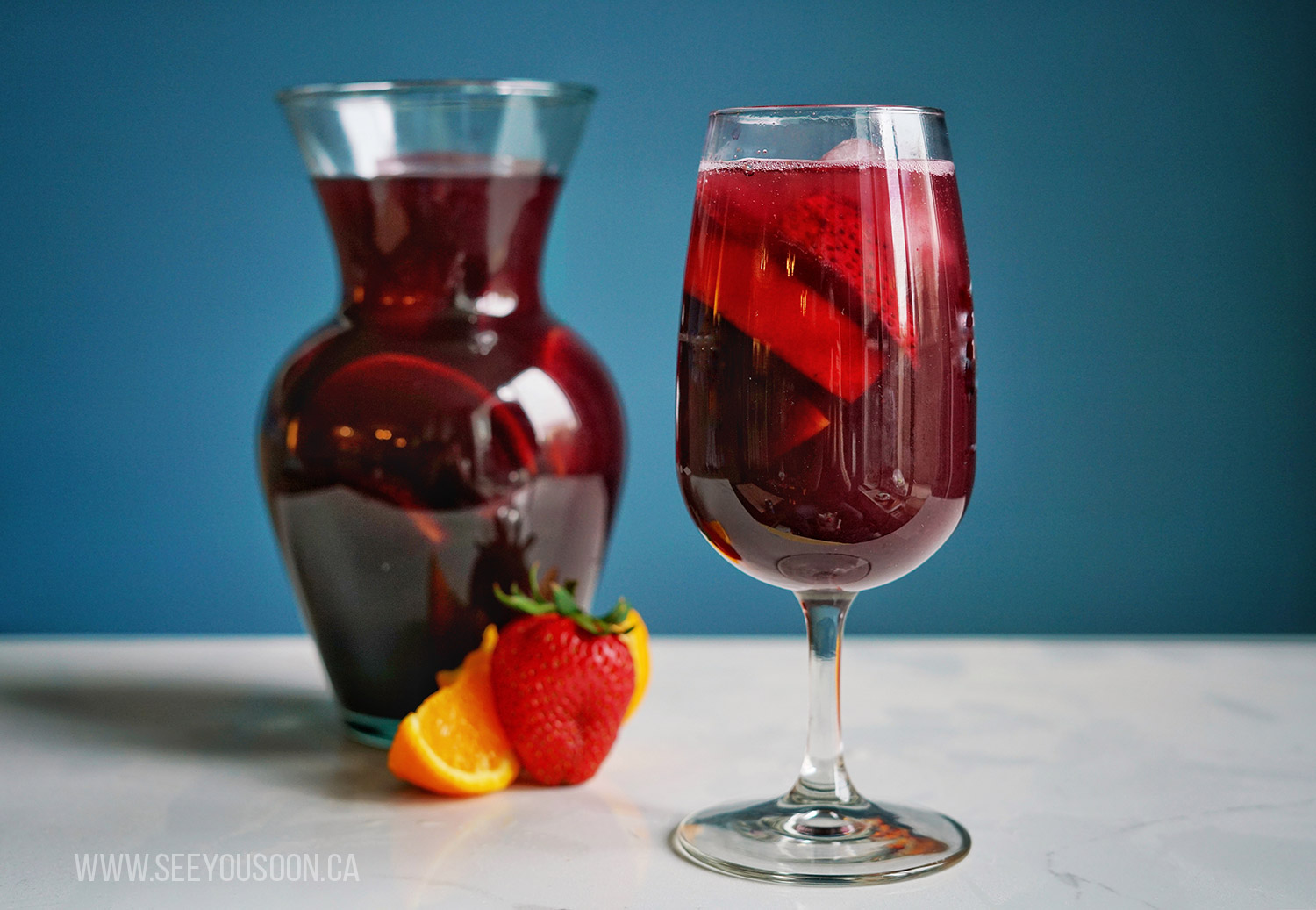 Sangria in a glass and a pitcher. Travel inspired cocktails.